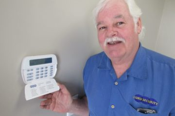 Brian McLeish of Guru Security standing at keypad